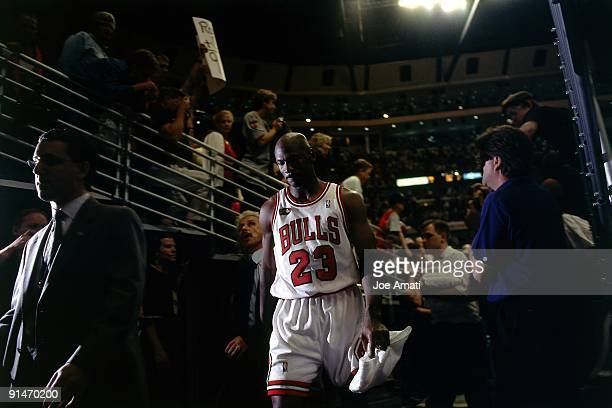 Michael Jordan of the Chicago Bulls walks off the court following Game Five of the 1998 NBA Finals played on June 12 1998 at the United Center in...