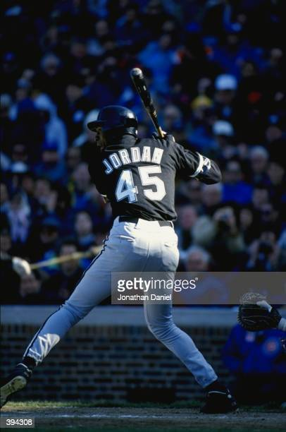Michael Jordan of the Chicago White Sox bats during a spring training game against the Chicago Cubs on April 7 1994 at Wrigley Field in Chicago...