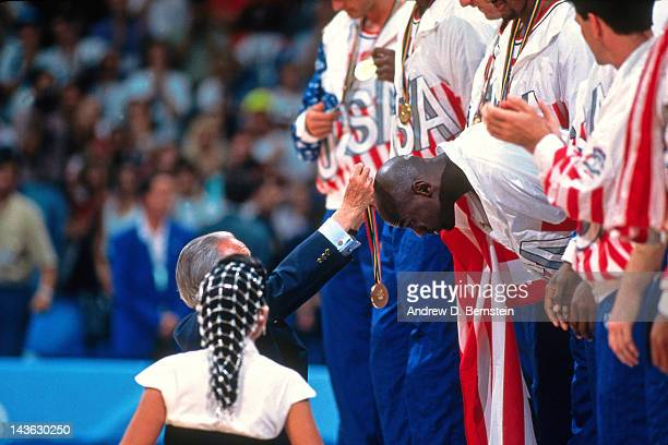 Michael Jordan of the United States Senior Mens team is presented a gold medal following a game against Croatia during the 1992 Olympics on August 8...