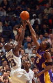 Michael Jordan of the Washington Wizards attempts to shoot the ball over Kobe Bryant of the Los Angeles Lakers during the game at MCI Center on...