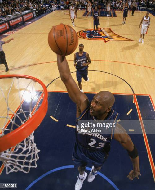 Michael Jordan of the Washington Wizards goes up for the dunk during the game against the Golden State Warriors at The Arena in Oakland on March 23...