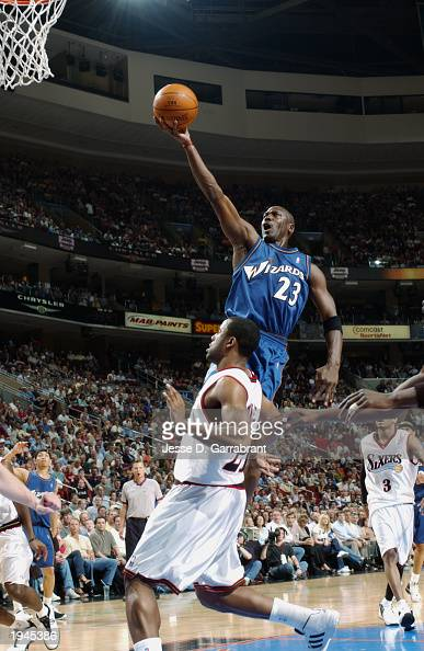 Michael Jordan of the Washington Wizards shoots over Greg Buckner of the Philadelphia 76ers during the game at First Union Center on April 16 2003 in...