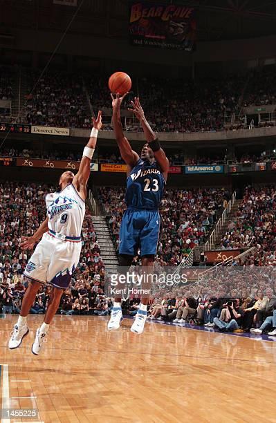 Michael Jordan of the Washington Wizards shoots over John Starks of the Utah Jazz at the Delta Center in Salt Lake City Utah DIGITAL IMAGE NOTE TO...
