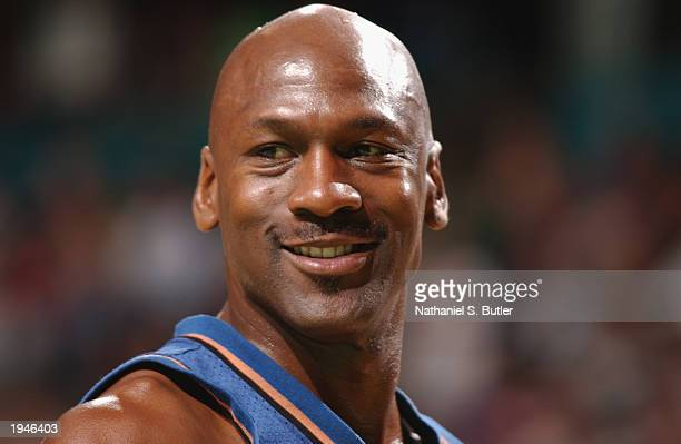 Michael Jordan of the Washington Wizards smiles as he bids farewell in his last game in the city of Boston during the NBA game against the Boston...