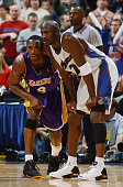 Michael Jordan of the Washington Wizards stands alongside Kobe Bryant of the Los Angeles Lakers during the game at the MCI Center on November 8 2002...
