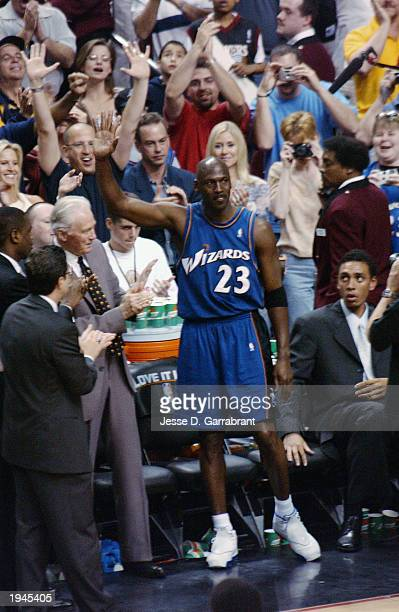 Michael Jordan of the Washington Wizards waves to the fans before the last game of his career which happened to be against the Philadelphia 76ers at...