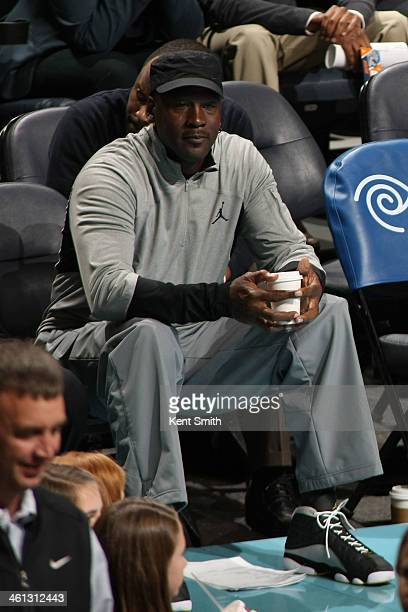 Michael Jordan Owner of the Charlotte Bobcats looks out over the crowd during the game against the Washington Wizards at the Time Warner Cable Arena...