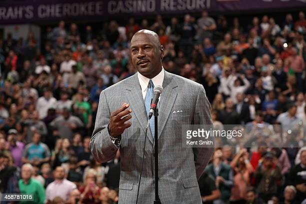 Michael Jordan Owner of the Charlotte Bobcats unveils the new Charlotte Hornets logo during the game against the Utah Jazz at the Time Warner Cable...