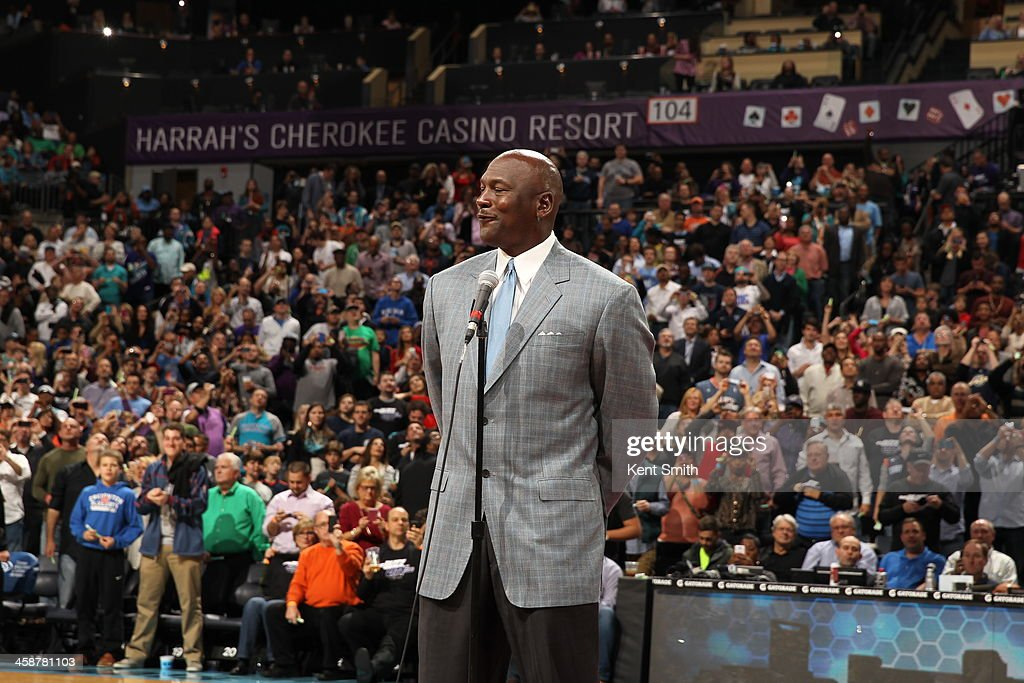 Michael Jordan, Owner of the Charlotte Bobcats unveils the new Charlotte Hornets logo during the game against the Utah Jazz at the Time Warner Cable Arena on December 21, 2013 in Charlotte, North Carolina.