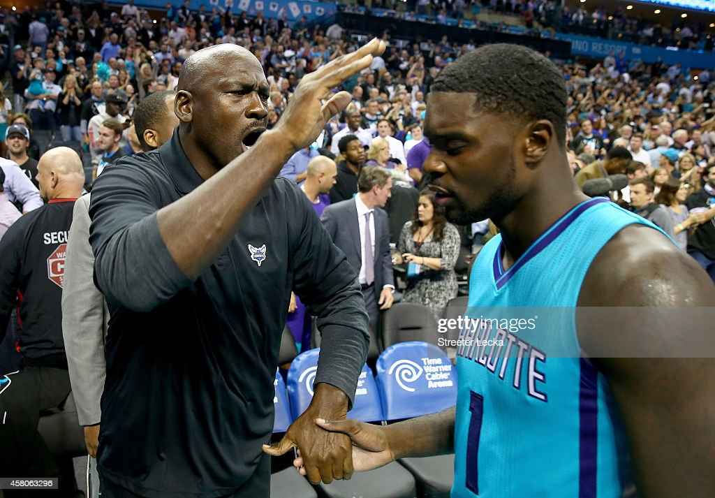 <a gi-track='captionPersonalityLinkClicked' href=/galleries/search?phrase=Michael+Jordan+-+Basketball+Player&family=editorial&specificpeople=73625 ng-click='$event.stopPropagation()'>Michael Jordan</a>, owner of the Charlotte Hornets, celebrates with <a gi-track='captionPersonalityLinkClicked' href=/galleries/search?phrase=Lance+Stephenson&family=editorial&specificpeople=5298304 ng-click='$event.stopPropagation()'>Lance Stephenson</a> #1 of the Charlotte Hornets after defeating the Milwaukee Bucks 108-106 in overtime at Time Warner Cable Arena on October 29, 2014 in Charlotte, North Carolina.