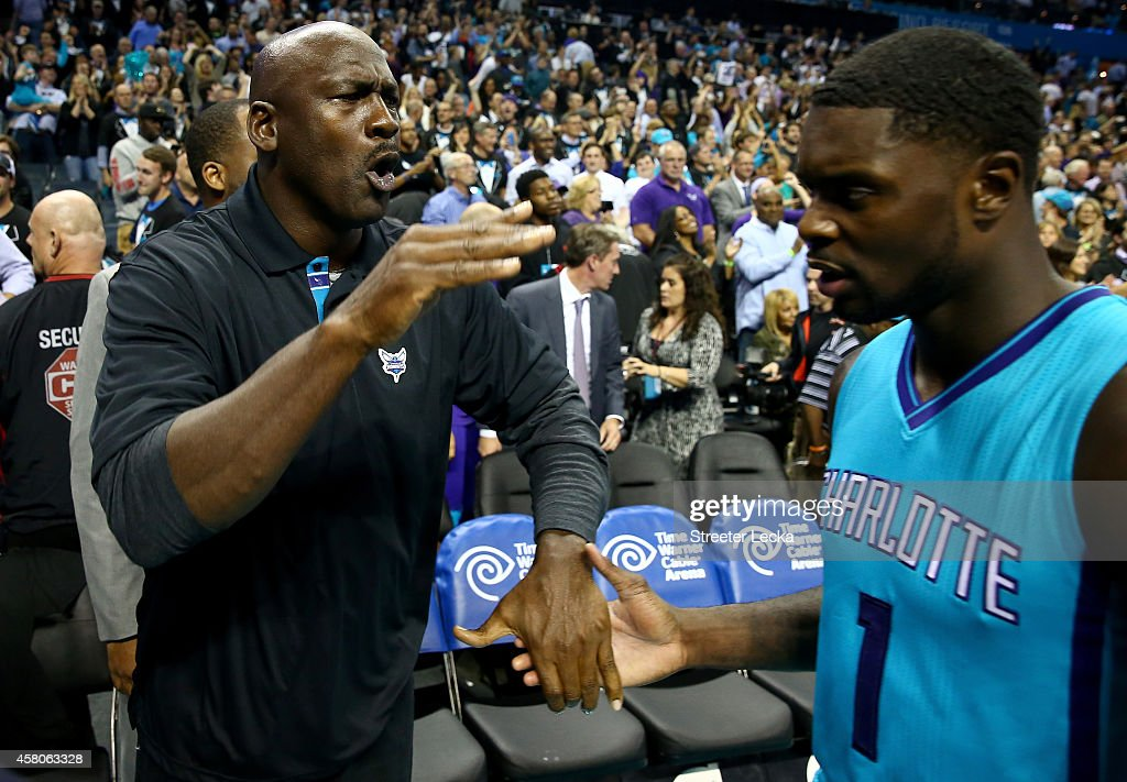 Michael Jordan owner of the Charlotte Hornets celebrates with Lance Stephenson of the Charlotte Hornets after defeating the Milwaukee Bucks 108106 in...