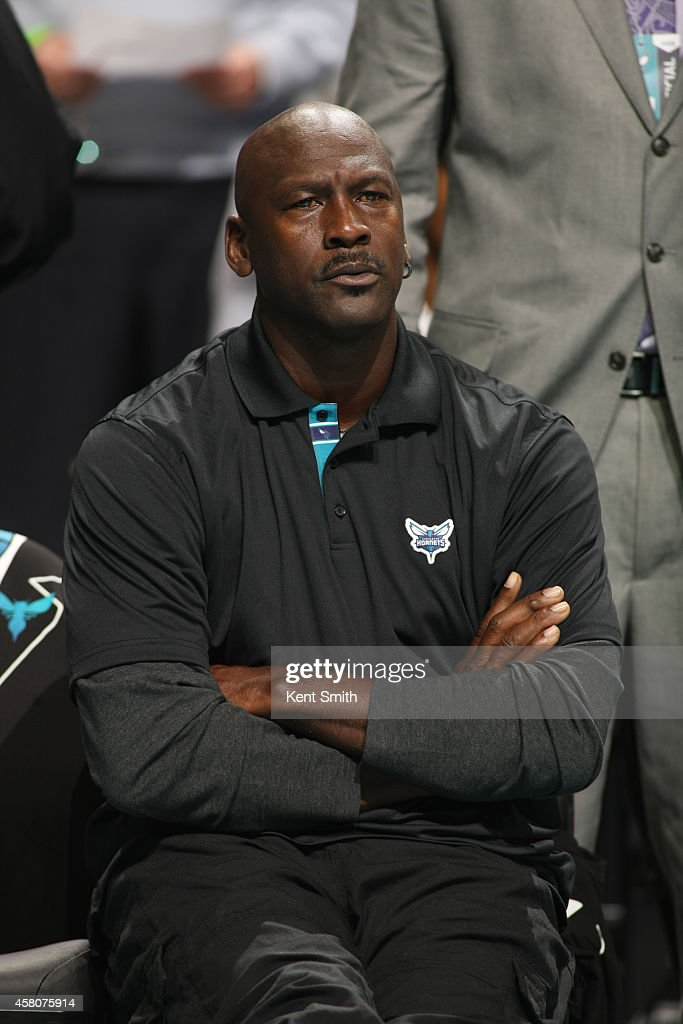 Michael Jordan, owner of the Charlotte Hornets looks on during the game against the Milwaukee Bucks at the Time Warner Cable Arena on October 29, 2014 in Charlotte, North Carolina.