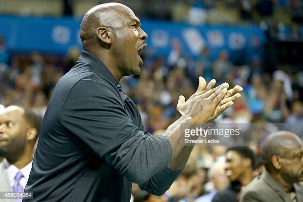 Michael Jordan owner of the Charlotte Hornets watches on during their game against the Milwaukee Bucks at Time Warner Cable Arena on October 29 2014...