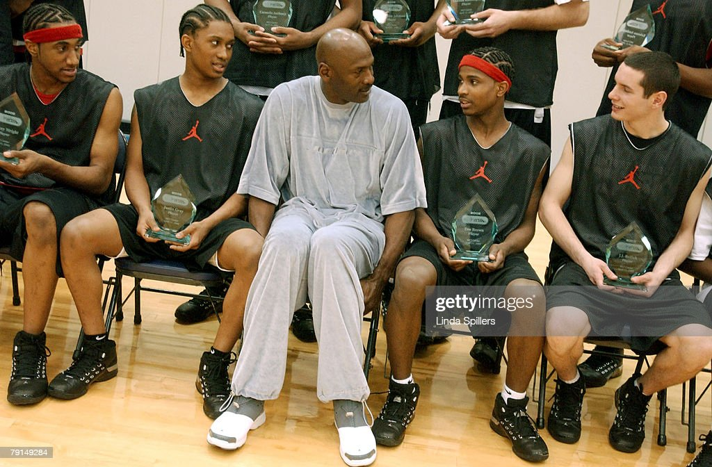 michael-jordan-talks-with-justin-gray-carmelo-anthony-dee-brown-and-picture-id79149284