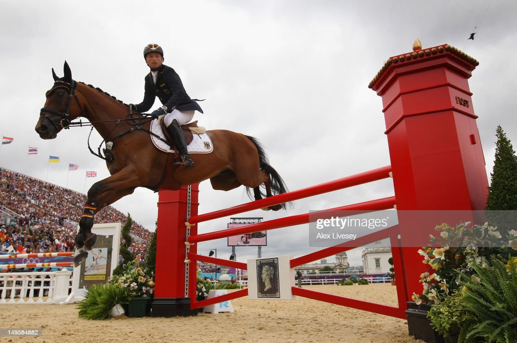 <a gi-track='captionPersonalityLinkClicked' href=/galleries/search?phrase=Michael+Jung+-+Equestrian&family=editorial&specificpeople=5533314 ng-click='$event.stopPropagation()'>Michael Jung</a> of Germany riding Sam in the Show Jumping Equestrian event on Day 4 of the London 2012 Olympic Games at Greenwich Park on July 31, 2012 in London, England.