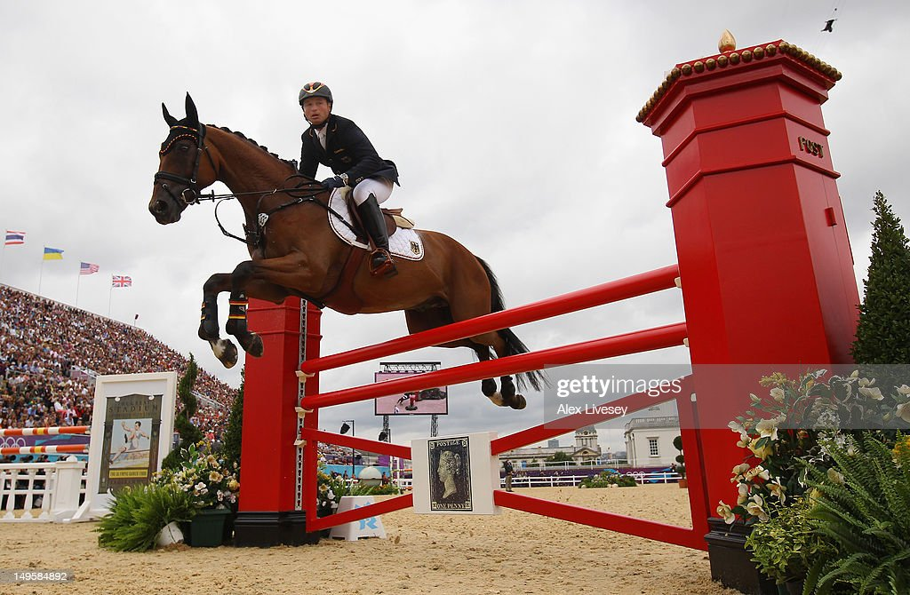 <a gi-track='captionPersonalityLinkClicked' href=/galleries/search?phrase=Michael+Jung&family=editorial&specificpeople=5533314 ng-click='$event.stopPropagation()'>Michael Jung</a> of Germany riding Sam in the Show Jumping Equestrian event on Day 4 of the London 2012 Olympic Games at Greenwich Park on July 31, 2012 in London, England.