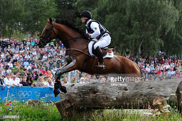 Michael Jung of Germany riding Sam negotiates a jump in the Eventing Cross Country Equestrian event on Day 3 of the London 2012 Olympic Games at...