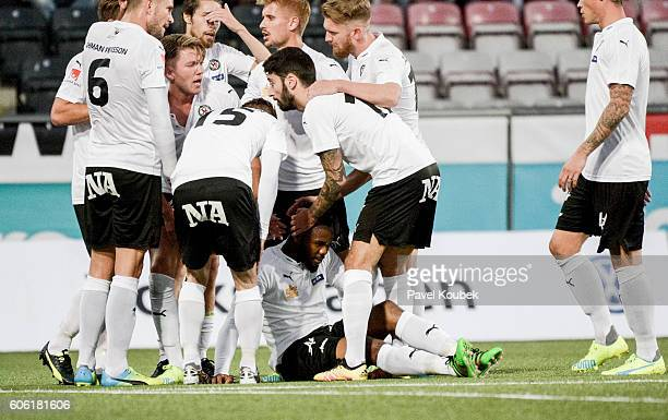 Michael Junior Omoh of Orebro SK is celebrated by teammates after scoring 11during the Allsvenskan match between Orebro SK GIF Sundsvall at Behrn...