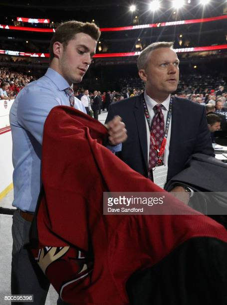 Michael Karow puts on his jersey after being selected 126th overall by the Arizona Coyotes during the 2017 NHL Draft at United Center on June 24 2017...
