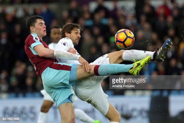 Michael Keane of Burnley challenges Fernando Llorente of Swansea City during the Premier League match between Swansea City and Burnley at The Liberty...