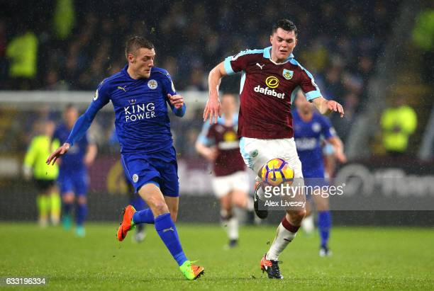 Michael Keane of Burnley is chased down by Jamie Vardy of Leicester City during the Premier League match between Burnley and Leicester City at Turf...