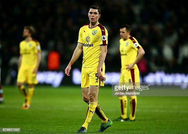 Michael Keane of Burnley is dejected after the final whistle during the Premier League match between West Ham United and Burnley at London Stadium on...