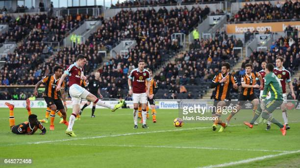 Michael Keane of Burnley scores his sides first goal during the Premier League match between Hull City and Burnley at KCOM Stadium on February 25...
