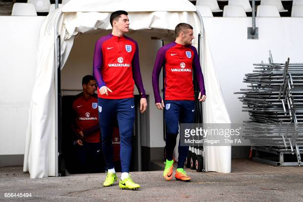 Michael Keane of England and Jamie Vardy of England walk out of the tunnel prior to a training session ahead of the international friendly match...