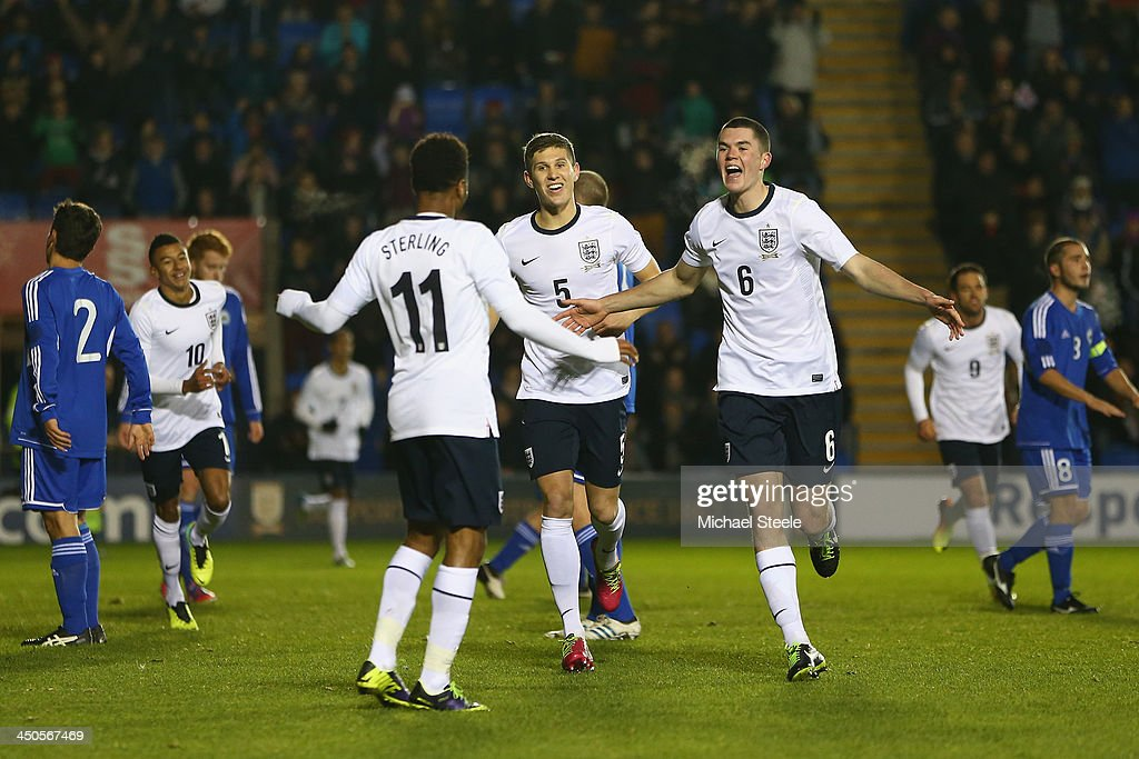 Michael Keane (R) of England celebrates scoring his sides opening goal during the 2015 UEFA European U21 Championship Qualifying match between England U21 and San Marino U21 at Greenhous Meadow on November 19, 2013 in Shrewsbury, England.