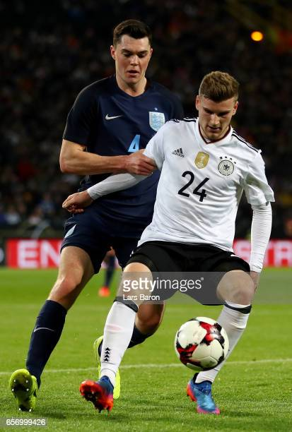 Michael Keane of England challenges Timo Werner of Germany during the international friendly match between Germany and England at Signal Iduna Park...