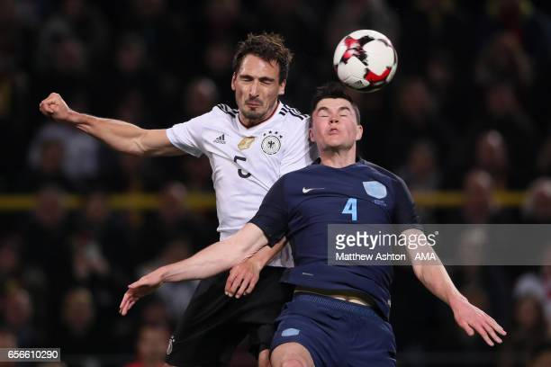 Michael Keane of England competes with Mats Hummels of Germany during the international friendly match between Germany and England at Signal Iduna...