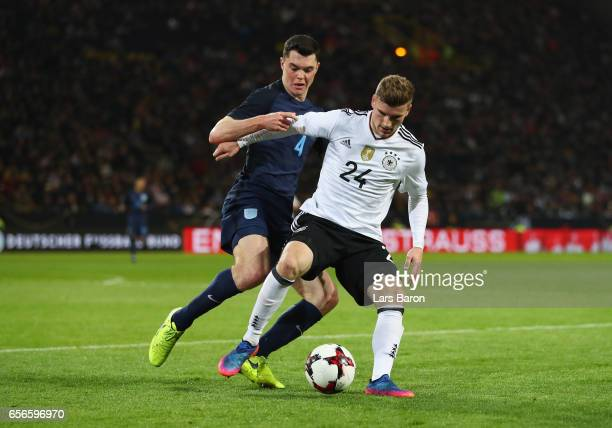 Michael Keane of England puts pressure on Timo Werner of Germany during the international friendly match between Germany and England at Signal Iduna...