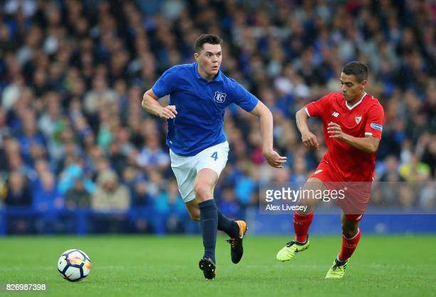 Michael Keane of Everton beats Wissam Ben Yedder of Sevilla during a preseason friendly match between Everton and Sevilla at Goodison Park on August...