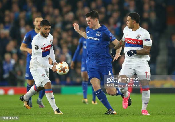 Michael Keane of Everton FC holds off a challenge from Memphis Depay of Olympique Lyon during the UEFA Europa League group E match between Everton FC...
