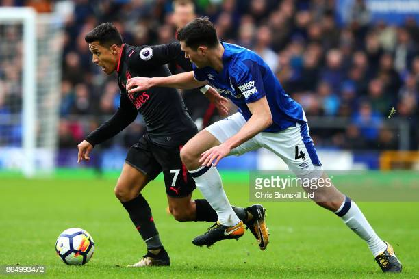 Michael Keane of Everton in action with Alexis Sanchez of Arsenal during the Premier League match between Everton and Arsenal at Goodison Park on...