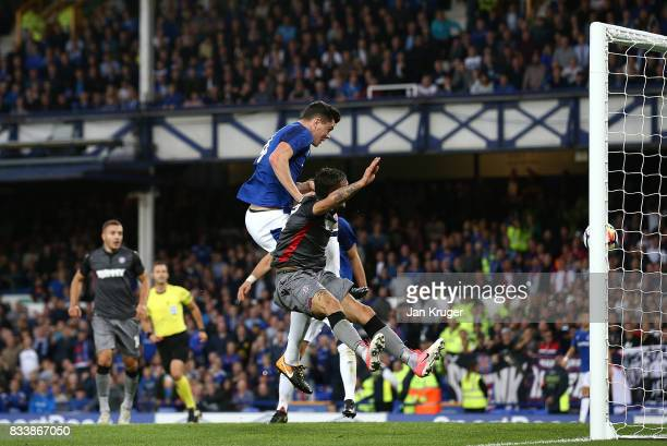 Michael Keane of Everton scores his sides opening goal during the UEFA Europa League Qualifying PlayOffs round first leg match between Everton FC and...