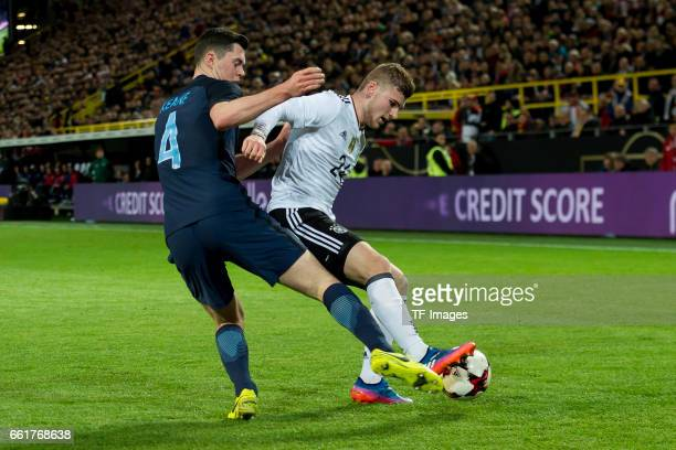 Michael Keane und Timo Werner of Germany battle for the ball during the international friendly match between Germany and England at Signal Iduna Park...