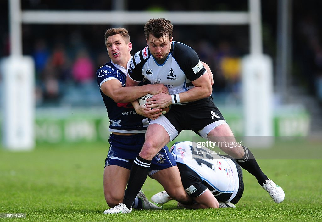 Michael Keating of Rotherham Titans is tackled by Auguy Slowik of Bristol during the Greene King IPA Championship Play Off First Leg match between Bristol Rugby and Rotherham Titans at The Memorial Ground on May 10, 2014 in Bristol, England.
