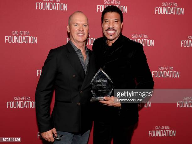 Michael Keaton and honoree Lionel Richie attend the SAGAFTRA Foundation Patron of the Artists Awards 2017 at the Wallis Annenberg Center for the...