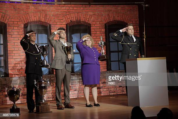 LIVE 'Michael Keaton' Episode 1679 Pictured Colin Jost Aidy Bryant and Taran Killam during the 'Neurotology Music Video' skit on April 4 2015