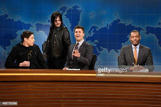 LIVE 'Michael Keaton' Episode 1679 Pictured Pete Davidson Norman Reedus Colin Jost and Michael Che during Weekend Update on April 4 2015
