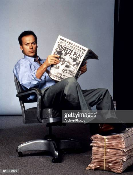 Michael Keaton holds a paper in publicity portrait for the film 'The Paper' 1994
