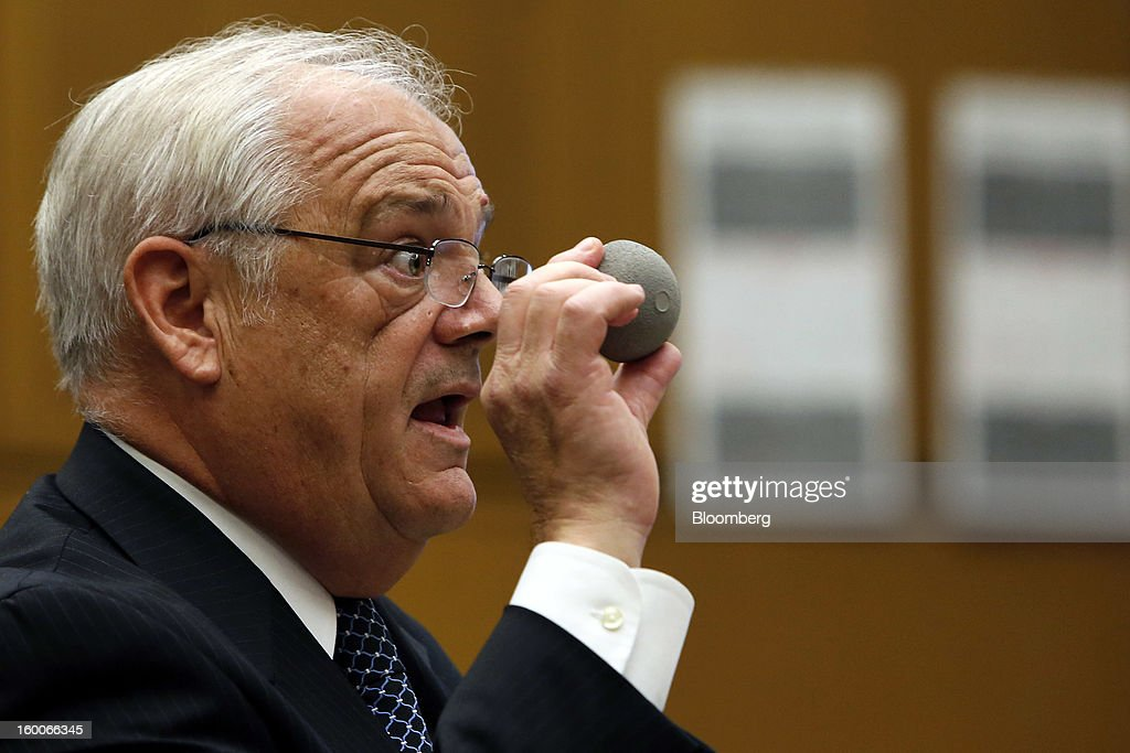 Michael Kelly, attorney for plaintiff Loren Kransky, holds up an ASR XL hip implant made by Johnson & Johnson during his opening statement to the jury at the trial of Kransky v. DePuy, at California Superior Court in Los Angeles, California, U.S., on Friday, Jan. 25, 2013. J&J failed to warn doctors of the risks of defective metal hip implants that it didn't test properly, a lawyer told a Los Angeles jury in the first of 10,000 lawsuits over the device to go to trial. Photographer: Patrick T. Fallon/Bloomberg via Getty Images