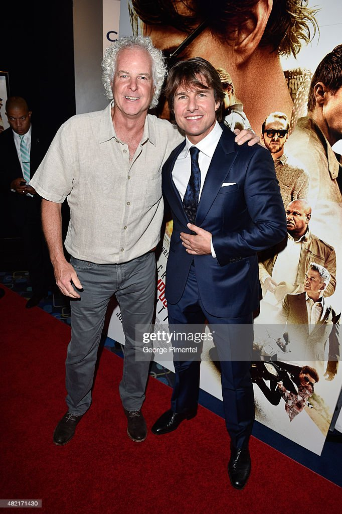 Michael Kennedy, EVP, Filmed Entertainment and actor Tom Cruise attend the Canadian Fan Premiere of 'Mission: Impossible Ð Rogue Nation' at the Cineplex Scotiabank Theatre on July 27, 2015 in Toronto, Canada.