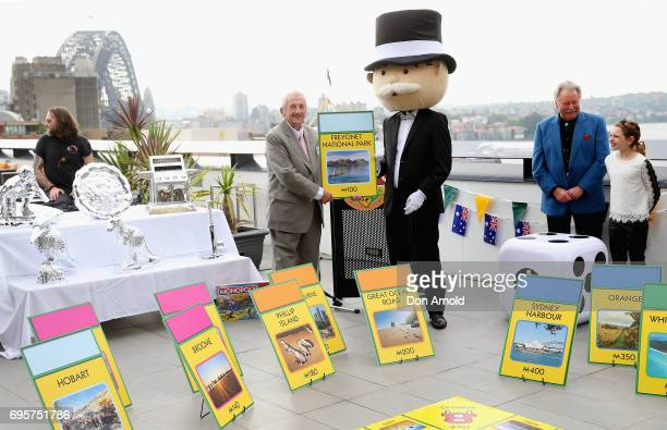 Michael Kent Mayor of Freycinet Tasmania holds up the card bearing the name of the town over which he presides during the launch of Monopoly's...