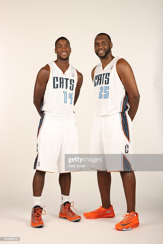 Michael Kidd-Gilchrist #14 and Al Jefferson #25 of the Charlotte Bobcats pose for a portrait on media day at the Time Warner Cable Arena on September 30, 2013 in Charlotte, North Carolina.