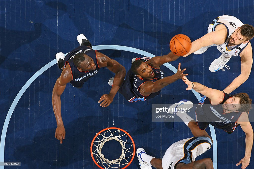 <a gi-track='captionPersonalityLinkClicked' href=/galleries/search?phrase=Michael+Kidd-Gilchrist&family=editorial&specificpeople=8526214 ng-click='$event.stopPropagation()'>Michael Kidd-Gilchrist</a> #14 and <a gi-track='captionPersonalityLinkClicked' href=/galleries/search?phrase=Josh+McRoberts+-+Basketball+Player&family=editorial&specificpeople=732530 ng-click='$event.stopPropagation()'>Josh McRoberts</a> #11 of the Charlotte Bobcats go up for a rebound against <a gi-track='captionPersonalityLinkClicked' href=/galleries/search?phrase=Marc+Gasol&family=editorial&specificpeople=661205 ng-click='$event.stopPropagation()'>Marc Gasol</a> #33 of the Memphis Grizzlies on April 9, 2013 at FedExForum in Memphis, Tennessee.