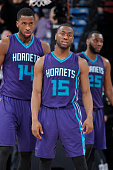 Michael KiddGilchrist and Kemba Walker of the Charlotte Hornets faces off against the Sacramento Kings on March 20 2015 at Sleep Train Arena in...