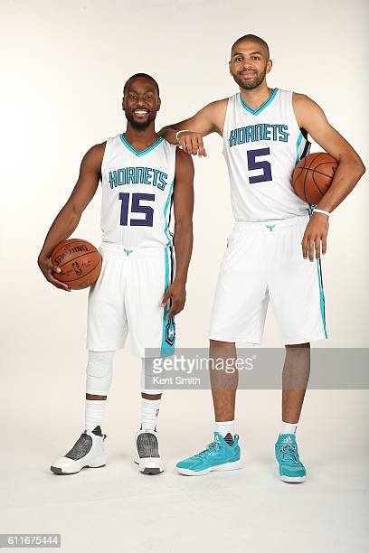 Michael KiddGilchrist and Nicolas Batum of Charlotte Hornets poses for Media Day Portraits at the Time Warner Cable Arena on September 26 2016 in...