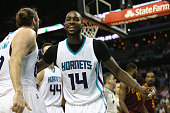 Michael KiddGilchrist holds back teammate Spencer Hawes of the Charlotte Hornets after an altercation with JR Smith of the Cleveland Cavaliers during...